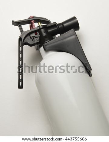 White bottle with chemical flame retardant/Fire Extinguisher/Fully pressurized household fire extinguisher. - stock photo