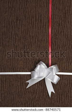 white bow on brown background - stock photo