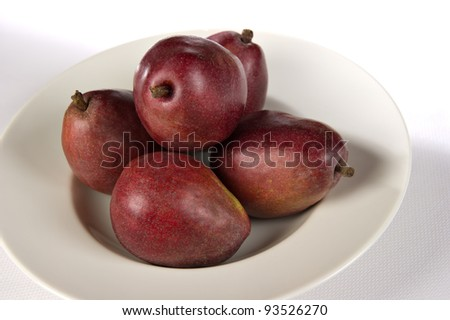 White bowl containing 5 red Anjou pears. - stock photo