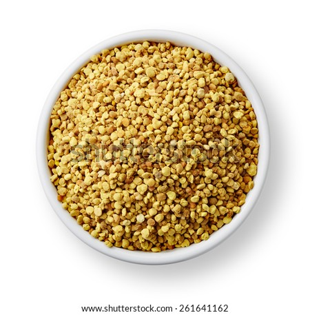 White bowl of bee pollen isolated on white background - stock photo
