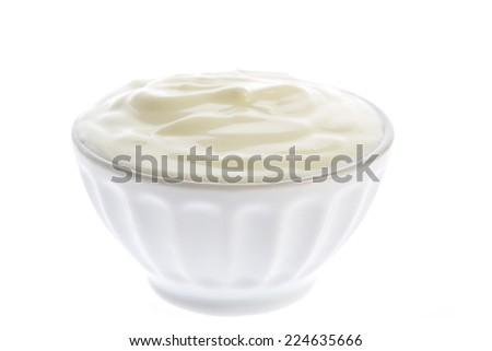 White bowl with yogurt isolated on white background - stock photo