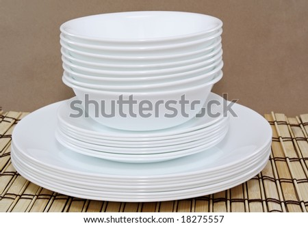 white bowls and plates stacked