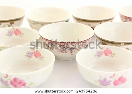White bowls with prints on white background. - stock photo