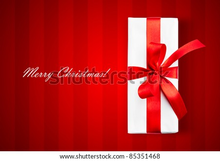 White box and stripped background. Merry Christmas text - stock photo
