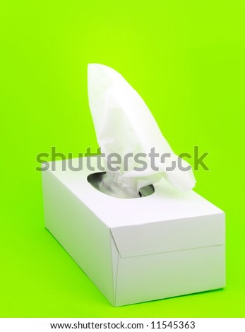 white box of facial tissue on green background - stock photo