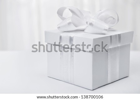 White box with a gift in a stylized white - stock photo