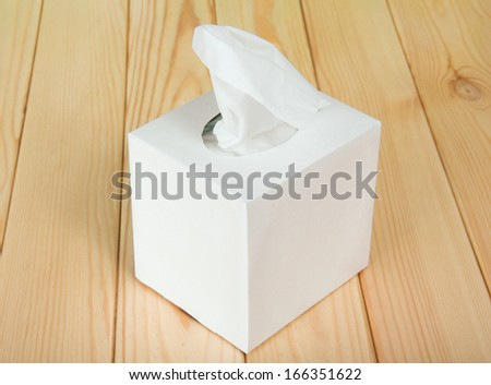 White box with napkins - stock photo