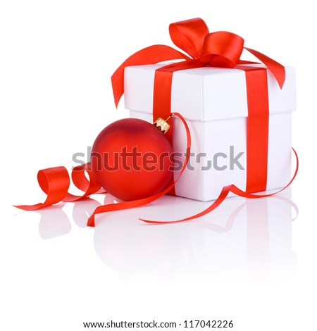 White boxs tied with a red satin ribbon bow and christmas ball Isolated on white background - stock photo