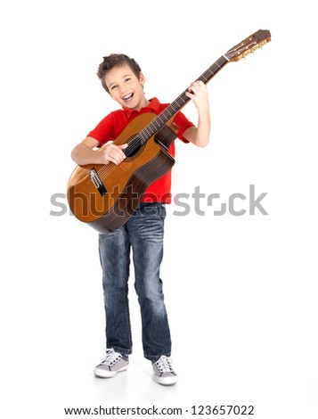 White  boy sings and plays on the acoustic guitar - isolated on white background - stock photo
