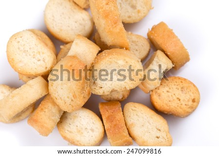 White bread croutons with salt on a white background - stock photo