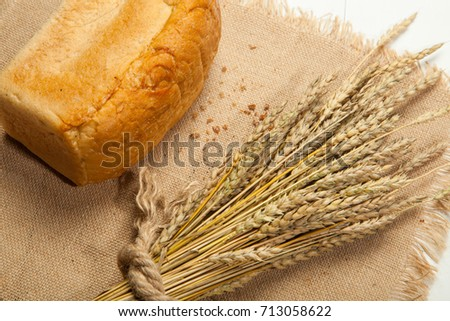 white bread or sliced bread in the basket on wooden floor with sack cloths.