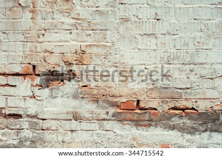 White brick cracked wall texture background. Vintage effect. - stock photo