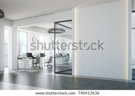 White brick open space office interior with a concrete floor, a blank wall fragment and a row of computer desks along the wall. Side view. 3d rendering mock up