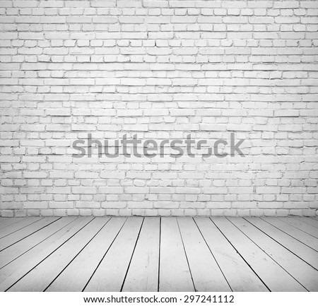 White brick wall and wooden floor interior - stock photo