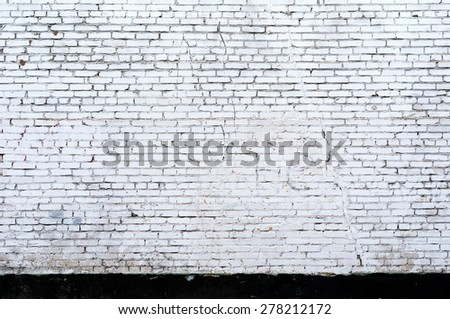 White brick wall background with copy space - stock photo