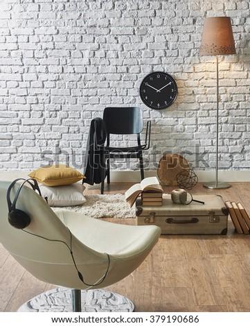 white brick wall interior black clock and suitcase - stock photo