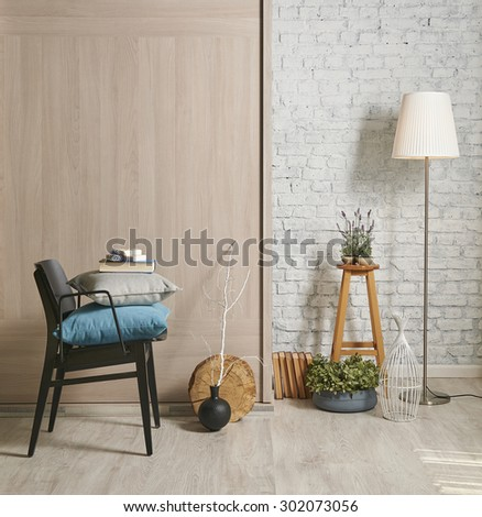 white brick wall interior style, lamp, pillow and  wooden wall - stock photo