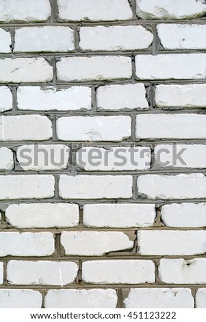 White brick wall. Texture of white brick wall, vertical composition - stock photo