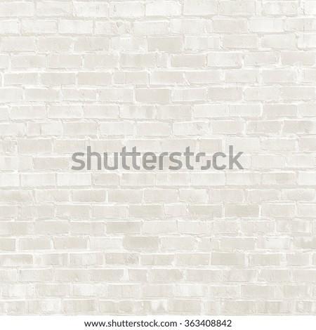 white brick wall texture - rough surface - stock photo