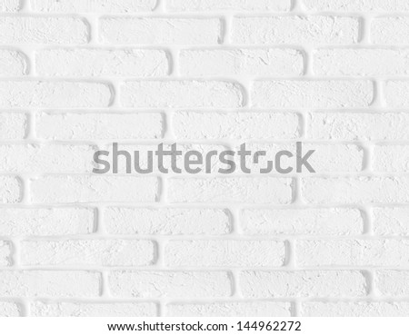 White brick wall texture with blank copy space. High quality seamless background. - stock photo