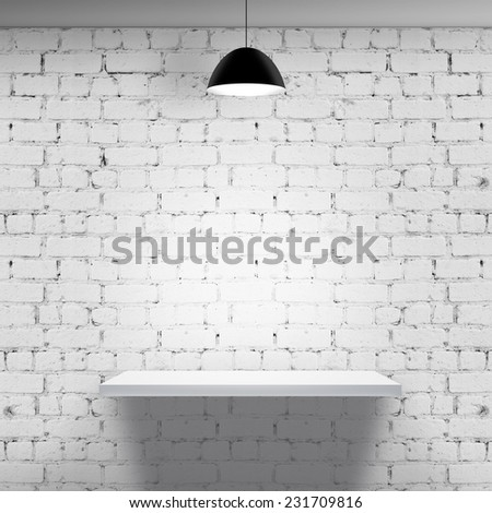 white brick wall with shelf and lamp - stock photo