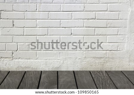 White brick wall with wooden floor