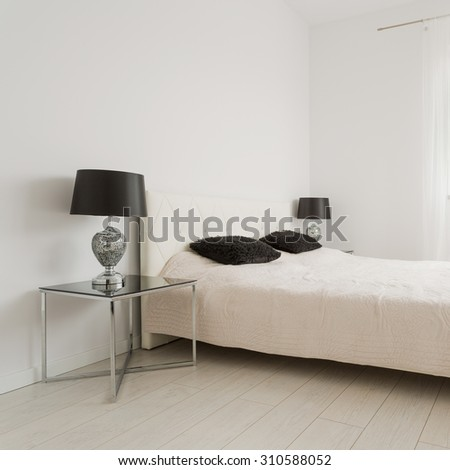 White bright bedroom decorated in classic style - stock photo