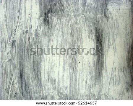 white brushstrokes on glass - stock photo