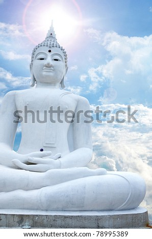 White Buddha and blue sky background - stock photo