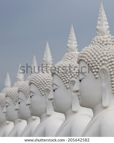 White Buddha statue in Thailand. - stock photo