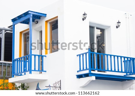 White building with blue balcony mediterranean style.