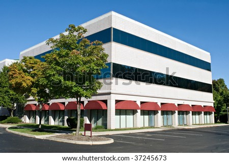 White Building with Red Awnings - stock photo