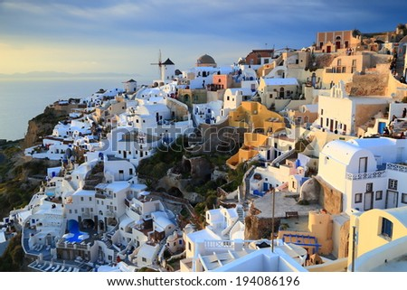 White buildings in Oia village at sunset, Santorini island, Greece - stock photo