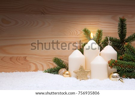 White burning candle for the first advent.