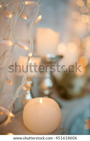 white burning candles and garland - stock photo