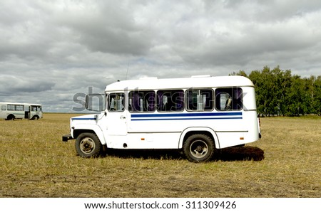 white bus in a wheat field