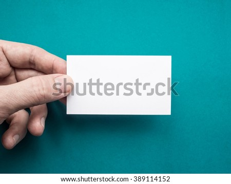 White business card Mockup in man's hand