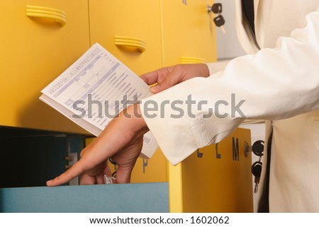 White business woman browsing files, close up - stock photo