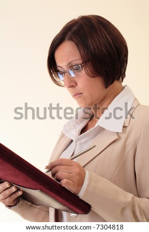 White businesswoman with notepad