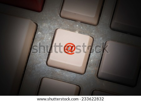 White button on a dirty old panel, selective focus - e-mail