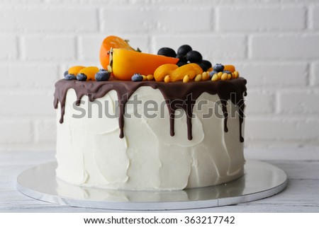 white cake with chocolate icing, food close-up - stock photo