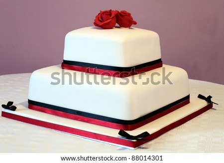 White Cake with Rose Design Icing - stock photo