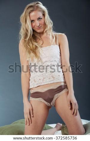 White camisole posing in studio  - stock photo