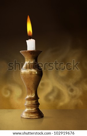 White candle on a candlestick