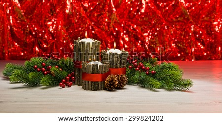 White candles in autumn winter decoration with real branch decoration