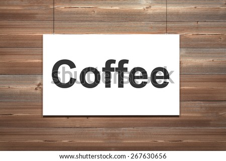 white canvas hanging on wooden wall coffee