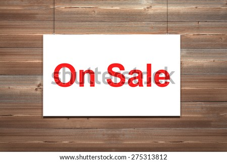 White canvas hanging on wooden wall on sale illustration