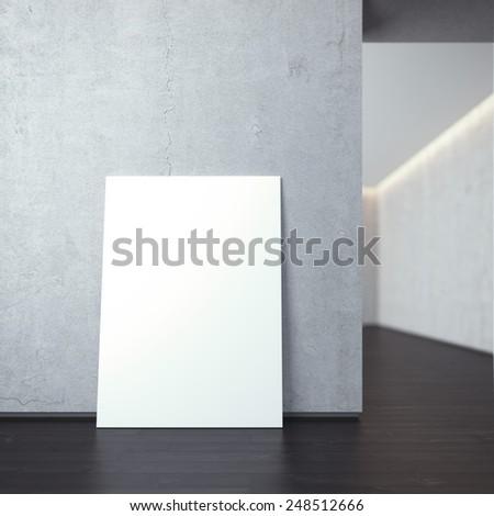 White canvas on a grey concrete wall - stock photo