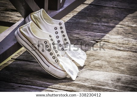 White canvas shoes, youth culture and style, Vintage Style.  - stock photo