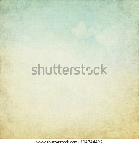 white canvas texture as old grunge background with delicate blue sky ans white clouds view - stock photo